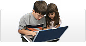 A boy and girl at a laptop